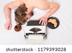 man with typewriter coffee lay... | Shutterstock . vector #1179393028