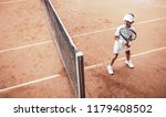 child playing tennis on outdoor ... | Shutterstock . vector #1179408502