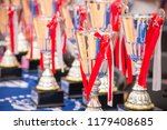pedestal with cups and prizes...   Shutterstock . vector #1179408685