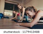women resting their abdomen on... | Shutterstock . vector #1179413488