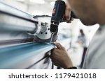 manual worker assembling pvc... | Shutterstock . vector #1179421018
