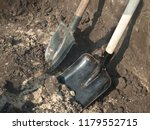 two shovels in the sand at a...   Shutterstock . vector #1179552715