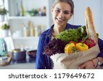 young woman holding grocery... | Shutterstock . vector #1179649672
