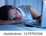 businesswoman napping in office ... | Shutterstock . vector #1179701938