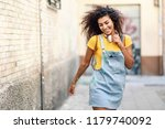 young african woman with... | Shutterstock . vector #1179740092
