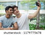 happy interracial gays posing... | Shutterstock . vector #1179775678