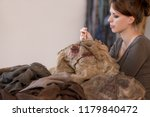 woman is sewing a scarecrow... | Shutterstock . vector #1179840472