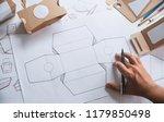 designer sketching drawing... | Shutterstock . vector #1179850498