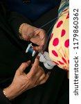 emirati woman is making... | Shutterstock . vector #1179860362