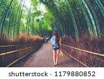 beautiful girl carrying shoes... | Shutterstock . vector #1179880852