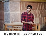 young indian student man at red ... | Shutterstock . vector #1179928588