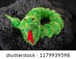 knitted snake on fleece | Shutterstock . vector #1179939598