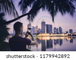 young man  tourist  taking... | Shutterstock . vector #1179942892