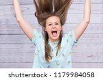1 white girl with disheveled... | Shutterstock . vector #1179984058