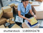 young woman packing of clothes...   Shutterstock . vector #1180042678