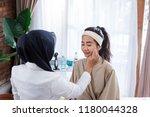 cosmetic doctor examining... | Shutterstock . vector #1180044328
