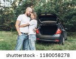 outdoor shot of young couple in ... | Shutterstock . vector #1180058278