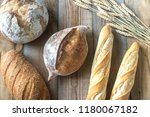 different kinds of bread on the ... | Shutterstock . vector #1180067182