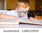 boy with down syndrome with big ... | Shutterstock . vector #1180122055
