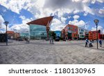 the newly opened forum shopping ... | Shutterstock . vector #1180130965