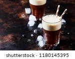 cold frappe coffee with ice and ... | Shutterstock . vector #1180145395