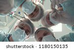 Surgical Team In Medical Masks...