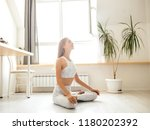 caucasian yogi female doing... | Shutterstock . vector #1180202392