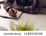 the man is writing a message in ... | Shutterstock . vector #1180218928