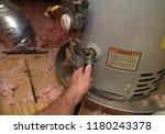 hand attaches hose to a home...
