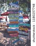 street sign on the beach... | Shutterstock . vector #1180257748