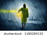 man at the coast coming in... | Shutterstock . vector #1180285132