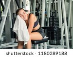 young fitness woman resting and ... | Shutterstock . vector #1180289188