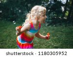kid child  trying to catch eat... | Shutterstock . vector #1180305952
