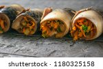 four rolls of mackerel with... | Shutterstock . vector #1180325158