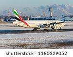 emirates airlines's boeing 777... | Shutterstock . vector #1180329052