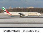 emirates airlines's boeing 777... | Shutterstock . vector #1180329112