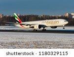 emirates airlines's boeing 777... | Shutterstock . vector #1180329115