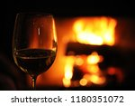 glass with red wine on the...   Shutterstock . vector #1180351072