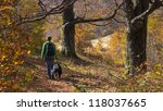 Stock photo a girl walking with her dog in colorful autumn forest in the mountains 118037665