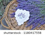 lavender flowers on straw  tray  | Shutterstock . vector #1180417558