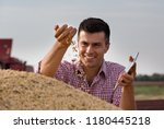 satisfied handsome farmer... | Shutterstock . vector #1180445218