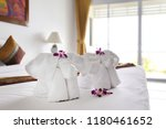 towels with elephant shape lay... | Shutterstock . vector #1180461652