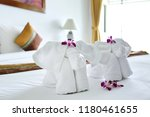 towels with elephant shape lay... | Shutterstock . vector #1180461655