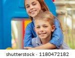 closeup portrait of a cute... | Shutterstock . vector #1180472182