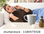 woman feeling sick and making a ... | Shutterstock . vector #1180475428