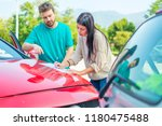 two drivers filling the... | Shutterstock . vector #1180475488