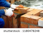 bricklayer installing bricks ... | Shutterstock . vector #1180478248