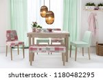 dining table with curtains and... | Shutterstock . vector #1180482295