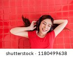 happy young woman lay on the... | Shutterstock . vector #1180499638
