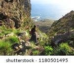 girl embarking steep descent | Shutterstock . vector #1180501495